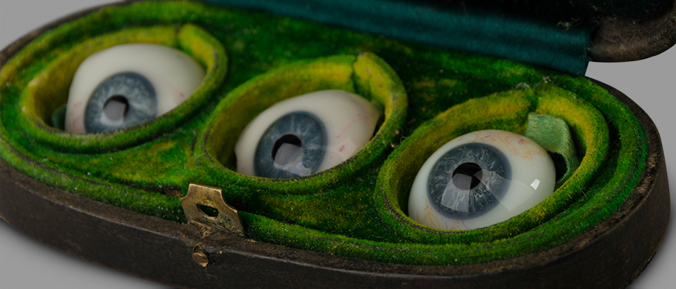 Three Glass Eyes in Their Storage Box